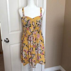 Yellow, floral, flowy mini dress.